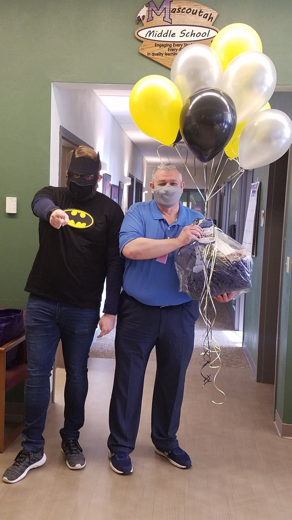 Mr. Dulcamara receives a birthday present from Batman