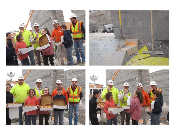 students give donuts to construction workers