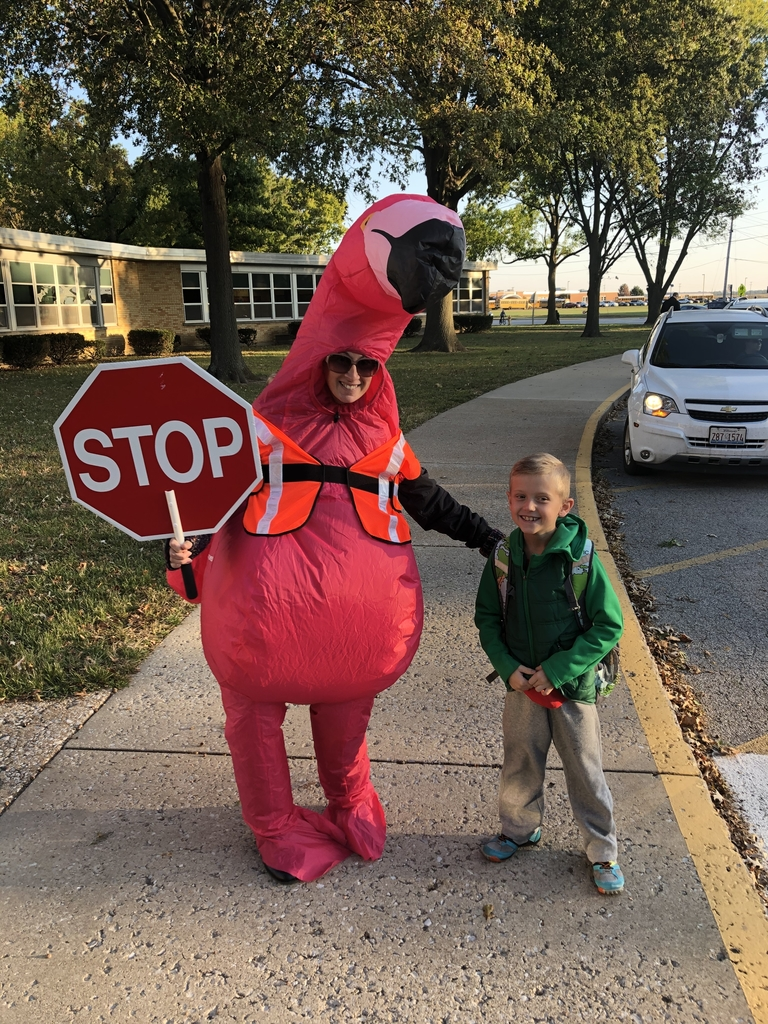 Mrs. Varady having fun helping kids cross the street.