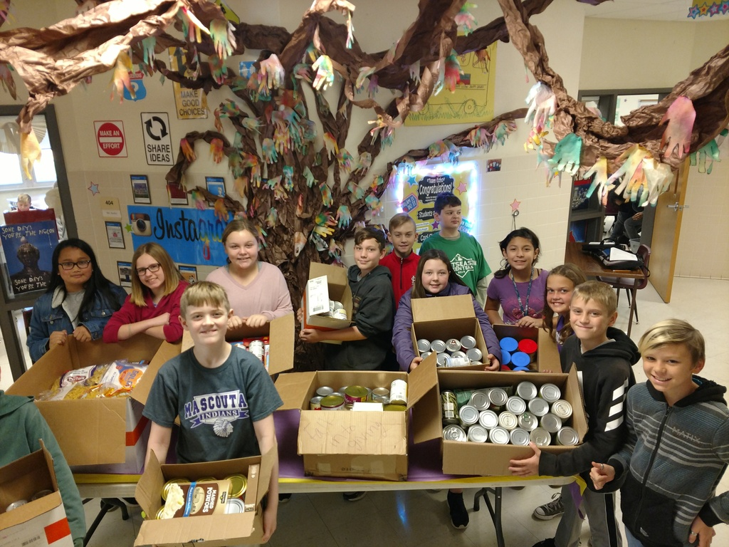 6th graders with canned goods