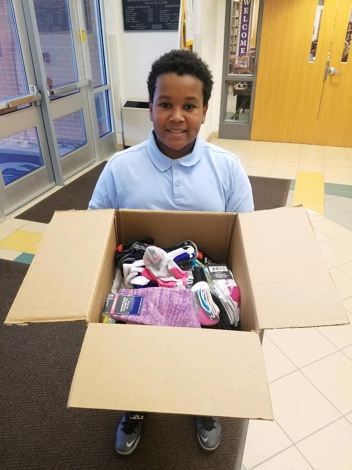 student collects socks for homeless
