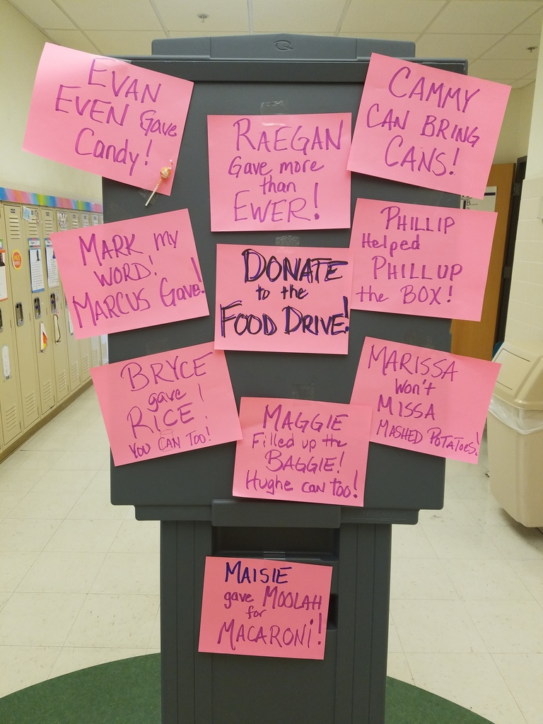 Mr. Amann writes notes about students that donated food