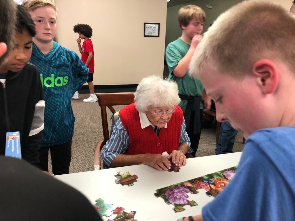 Assisted Living residents puzzle with RRR